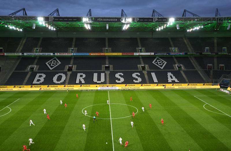 An overview shows the empty stadium during the German first division Bundesliga football match Borussia Moenchengladbach v 1 FC Cologne in Moenchengladbach, western Germany on March 11, 2020. - Rhine Bundesliga derby between Borussia Moenchengladbach and Cologne, will be held behind closed doors due to the coronavirus, the first game in Bundesliga history to be played without fans. (Photo by Ina FASSBENDER / AFP) / DFL REGULATIONS PROHIBIT ANY USE OF PHOTOGRAPHS AS IMAGE SEQUENCES AND/OR QUASI-VIDEO