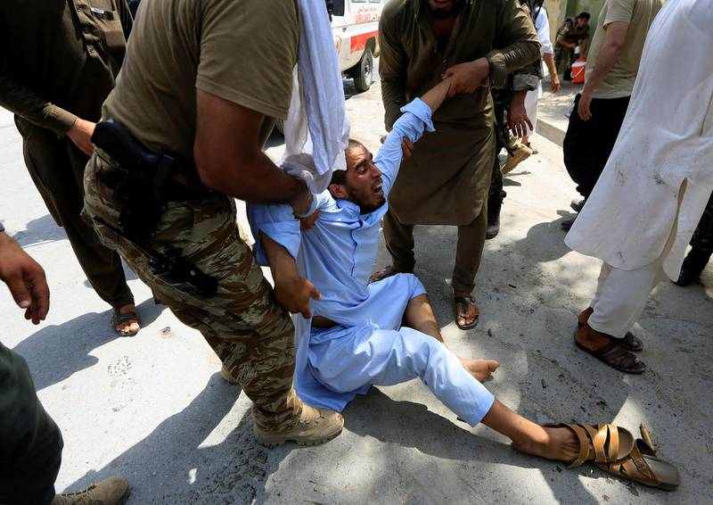 A man reacts after an attack in Jalalabad city, Afghanistan July 11, 2018.   REUTERS/Parwiz