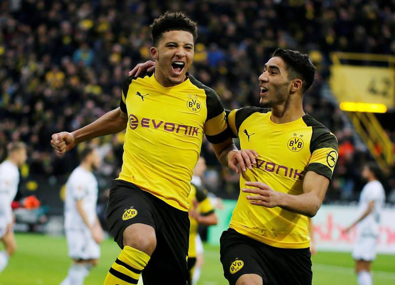 Soccer Football - Bundesliga - Borussia Dortmund v TSG 1899 Hoffenheim - Signal Iduna Park, Dortmund, Germany - February 9, 2019  Borussia Dortmund's Jadon Sancho celebrates scoring a goal with Achraf Hakimi before it is disallowed after a referral to VAR   REUTERS/Leon Kuegeler  DFL regulations prohibit any use of photographs as image sequences and/or quasi-video     TPX IMAGES OF THE DAY