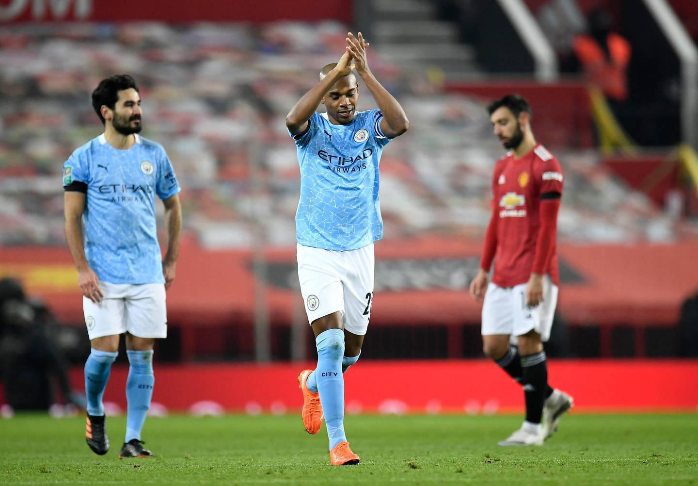 """Manchester City's Fernandinho celebrates after scoring his side's second goal of the game during the Carabao Cup Semi-Final match at Old Trafford, Manchester. PA Photo. Picture date: Wednesday January 6, 2021. See PA story SOCCER Man Utd. Photo credit should read: Peter Powell/PA Wire. RESTRICTIONS: EDITORIAL USE ONLY No use with unauthorised audio, video, data, fixture lists, club/league logos or """"live"""" services. Online in-match use limited to 120 images, no video emulation. No use in betting, games or single club/league/player publications."""