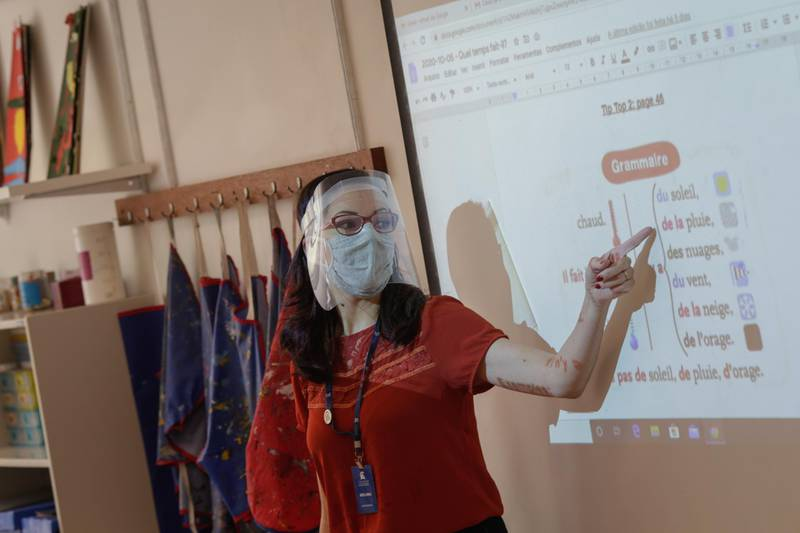A teacher wearing a protective mask and face shield speaks during a French lesson at a school in Rio de Janeiro, Brazil, on Monday, Oct. 5, 2020. As officials begin to reopen large parts of the country, the number of confirmed cases in the coronavirus outbreak in Brazil stands at 4.92 million, with spikes not seen slowing. Photographer: Andre Coelho/Bloomberg