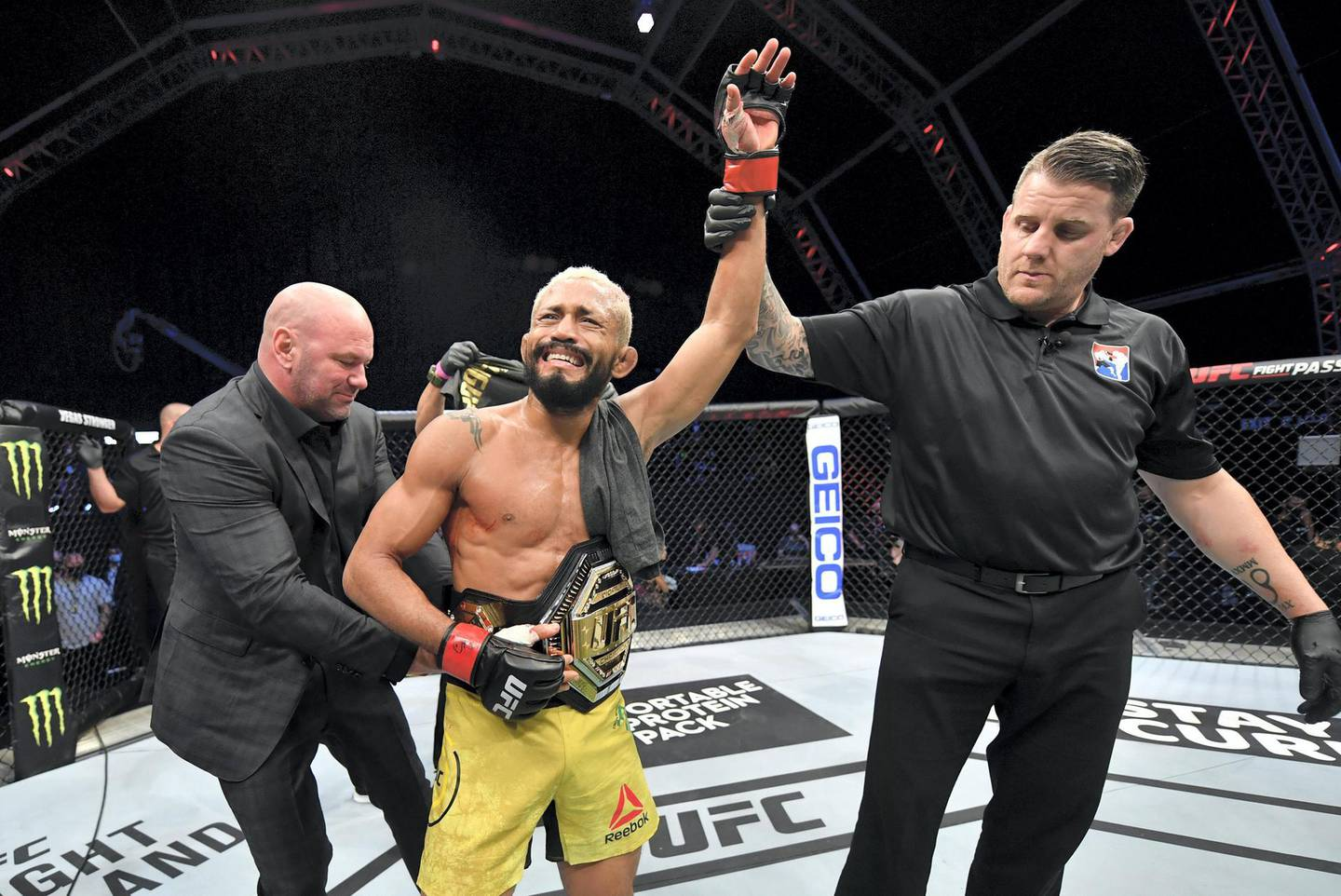 ABU DHABI, UNITED ARAB EMIRATES - JULY 19: Deiveson Figueiredo of Brazil celebrates after defeating Joseph Benavidez in their UFC flyweight championship bout during the UFC Fight Night event inside Flash Forum on UFC Fight Island on July 19, 2020 in Yas Island, Abu Dhabi, United Arab Emirates. (Photo by Jeff Bottari/Zuffa LLC via Getty Images) *** Local Caption *** ABU DHABI, UNITED ARAB EMIRATES - JULY 19: Deiveson Figueiredo of Brazil celebrates after defeating Joseph Benavidez in their UFC flyweight championship bout during the UFC Fight Night event inside Flash Forum on UFC Fight Island on July 19, 2020 in Yas Island, Abu Dhabi, United Arab Emirates. (Photo by Jeff Bottari/Zuffa LLC via Getty Images)
