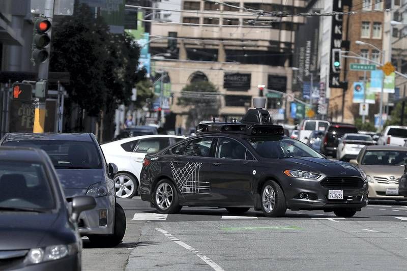 (FILES) In this file photo taken on March 27, 2017 an Uber self-driving car drives down 5th Street on March 28, 2017 in San Francisco, California.  The race to perfect robot cars continues despite fears kindled by the death of a woman hit by a self-driving Uber vehicle while pushing a bicycle across an Arizona street. Uber put a temporary halt to its self-driving car program in the US after the fatal accident this month near Phoenix, where several other companies including Google-owned Waymo are testing such technology.  / AFP PHOTO / Getty Images North America / JUSTIN SULLIVAN /  With AFP Story by Ian TIMBERLAKE:  US-lifestyle-internet-automobile-Uber,foucs