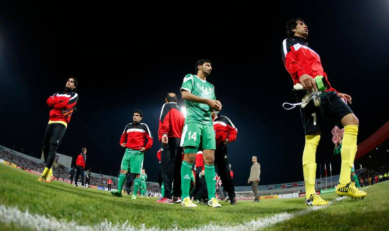 Iraq's team walk off the pitch after losing their final game against UAE at the Gulf Cup Tournament in Isa Town, January 18, 2013. REUTERS/Fadi Al-Assaad (BAHRAIN - Tags: SPORT SOCCER) *** Local Caption ***  BAH26D_SOCCER-_0118_11.JPG