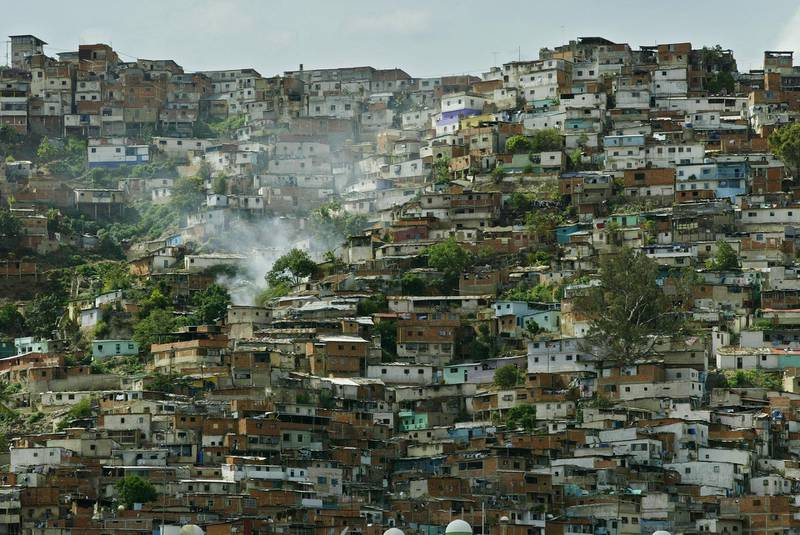 CARACAS, VENEZUELA - MAY 21:  Hillside slums are shown May 21, 2003 in Caracas, Venezuela. The Central Bank reported May 23, 2003 Venezuela's economy is down 29 percent in the first quarter, a record collapse due in part to an anti-government strike and strict currency controls. The country's oil industry, which makes up for half of government revenues, fell 46.7 percent.  (Photo by Kimberly White/Getty Images)