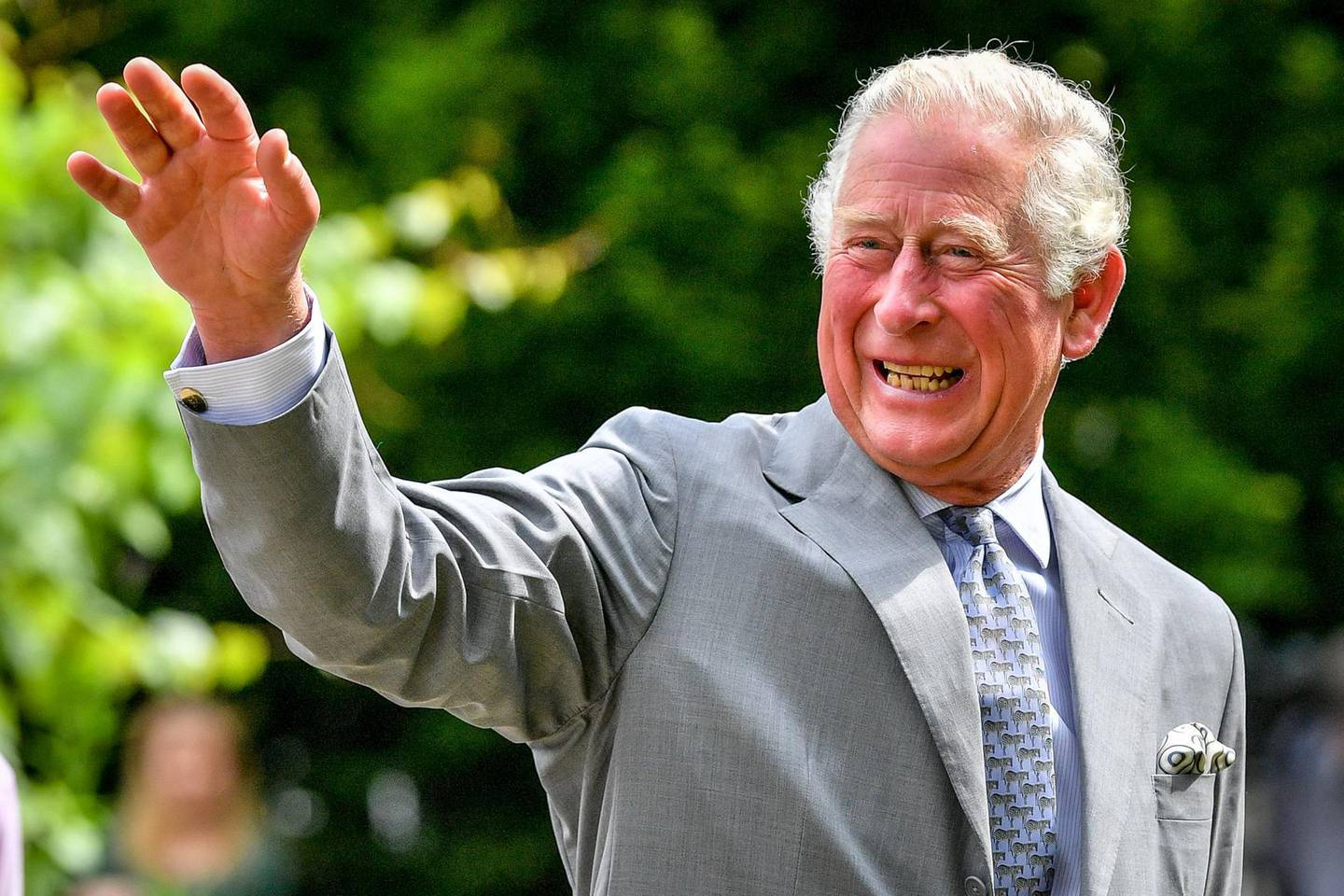 GLOUCESTER, ENGLAND - JUNE 16: Prince Charles, Prince of Wales gestures to crowds of hospital staff watching from a distance as he chats with front line key workers who who have responded to the COVID-19 pandemic during a visit to Gloucestershire Royal Hospital on June 16, 2020 in Gloucester, England. (Photo by WPA Pool-Ben Birchall/Getty Images)