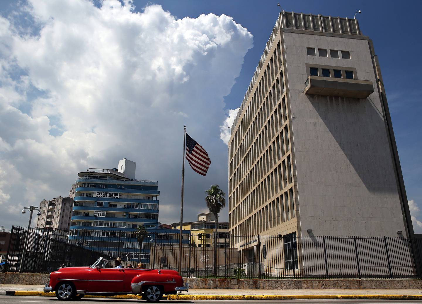 epa06134953 (FILE) - A classic car passes in front of the US embassy in Havana, Cuba, 16 June 2017 (reissued 10 August 2017). Media outlets report that the US State Department has expelled two diplomats from the Cuban Embassy in Washington, following an alleged 'acoustic attack' on employees at the US embassy in Havana. Sonic devices were reportedly used in the attack that left at least two with serious health problems.  EPA/Alejandro Ernesto