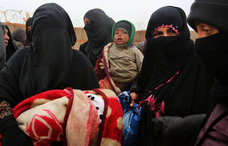 """(FILES) In this file photo taken on March 01, 2017 Syrian refugee patients from the makeshift Rukban camp, which lies in no-man's-land off the border between Syria and Jordan in the remote northeast, queue up to visit a UN-operated medical clinic immediately on the Jordanian-side for checkups, on March 1, 2017. The United Nations said on August 30, 2019, it will help evacuate civilians from an """"abysmal"""" Syrian desert camp near the border with Jordan, after a mission last week determined who wanted to leave. / AFP / KHALIL MAZRAAWI"""