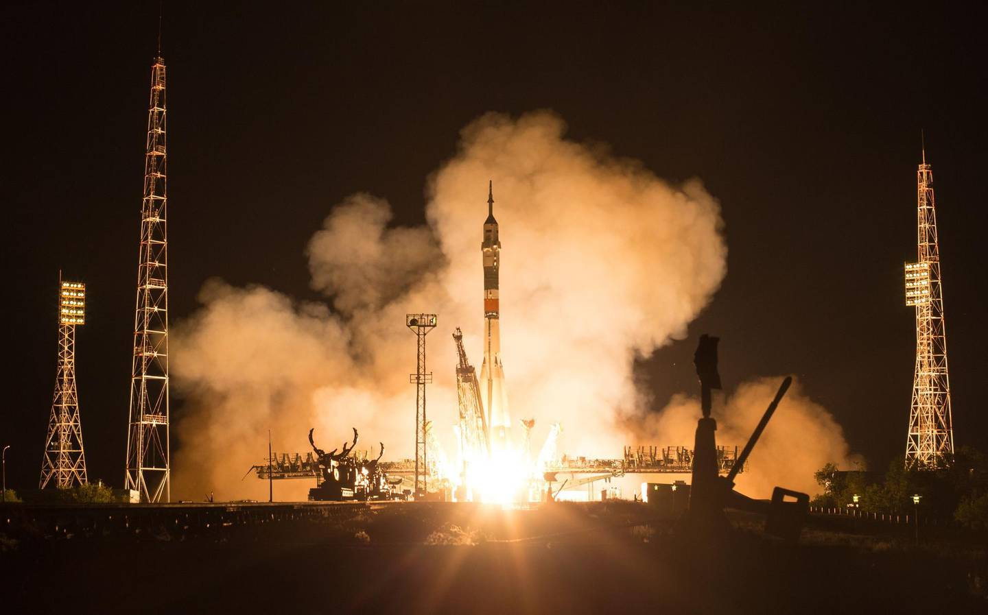 """TOPSHOT - This handout photo released by NASA shows The Soyuz MS-13 rocket launch with Expedition 60 Soyuz Commander Alexander Skvortsov of Roscosmos, flight engineer Drew Morgan of NASA, and flight engineer Luca Parmitano of ESA (European Space Agency), Saturday, July 20, 2019 at the Baikonur Cosmodrome in Kazakhstan. Skvortsov, Morgan, and Parmitano launched at 12:28 p.m. Eastern time (9:28 p.m. Baikonur time) to begin their mission to the International Space Station.   - RESTRICTED TO EDITORIAL USE - MANDATORY CREDIT """"AFP PHOTO / NASA /Joel Kowsky """" - NO MARKETING NO ADVERTISING CAMPAIGNS - DISTRIBUTED AS A SERVICE TO CLIENTS  / AFP / NASA / NASA / Joel KOWSKY / RESTRICTED TO EDITORIAL USE - MANDATORY CREDIT """"AFP PHOTO / NASA /Joel Kowsky """" - NO MARKETING NO ADVERTISING CAMPAIGNS - DISTRIBUTED AS A SERVICE TO CLIENTS"""
