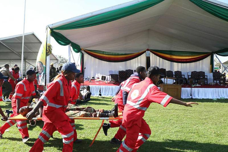 epa06834324 Members of the Zimbabwe Red Cross Society (ZRCS) carry an injured member of the Zimbabwe National Army (ZNA), who was reportedly injured after a suspected bomb went off at a rally addressed by President Emmerson Mnangagwa, at White City Stadium in Bulawayo, Zimbabwe, 23 June 2018. According to media reports, an apparent bomb attack rocked Zimbabwean President Emmerson Mnangagwa's election rally on 23 June in Bulawayo. The incident left multiple people injured, media added. 'The president was evacuated successfully,' his spokesman said.  EPA/STRINGER