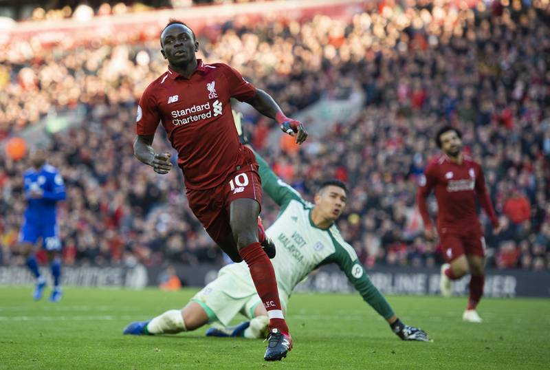 epa07124469 Liverpool's Sadio Mane celebrates scoring the fifth goal making the score 4-1 during the English Premier League soccer match between Liverpool and Cardiff City at the Anfield in Liverpool, Britain, 27 October 2018.  EPA/PETER POWELL EDITORIAL USE ONLY. No use with unauthorized audio, video, data, fixture lists, club/league logos or 'live' services. Online in-match use limited to 75 images, no video emulation. No use in betting, games or single club/league/player publications