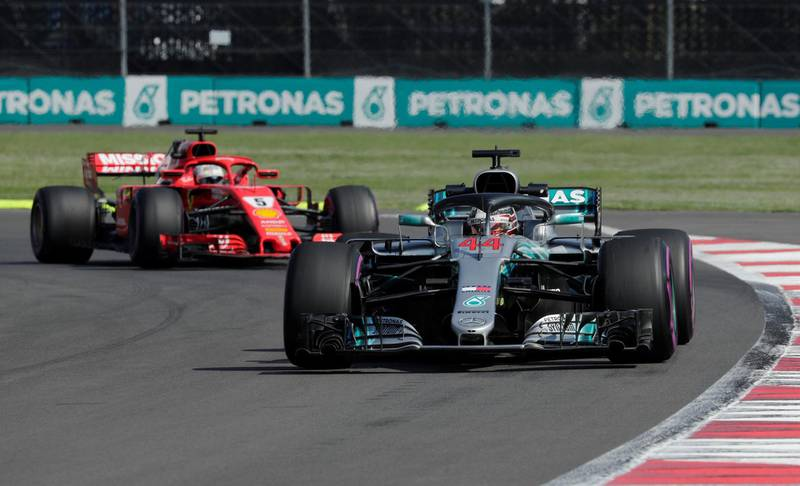 Formula One F1 - Mexican Grand Prix - Autodromo Hermanos Rodriguez, Mexico City, Mexico - October 26, 2018  Mercedes' Lewis Hamilton and Ferrari's Sebastian Vettel during practice  REUTERS/Andres Stapff