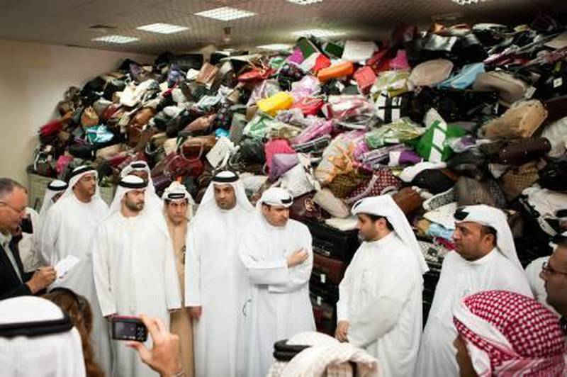 DUBAI, UAE (07/03/2011) His Excellency Mr Sami Dhaen Al Qamzi, Director General of the Department of Economic Development (DED) show cases the departments largest collection of confiscated counterfeit goods. The goods are due to be destroyed as part of the DED's crack down on illegal counterfeit goods into the UAE. (Callaghan Walsh / for The National)
