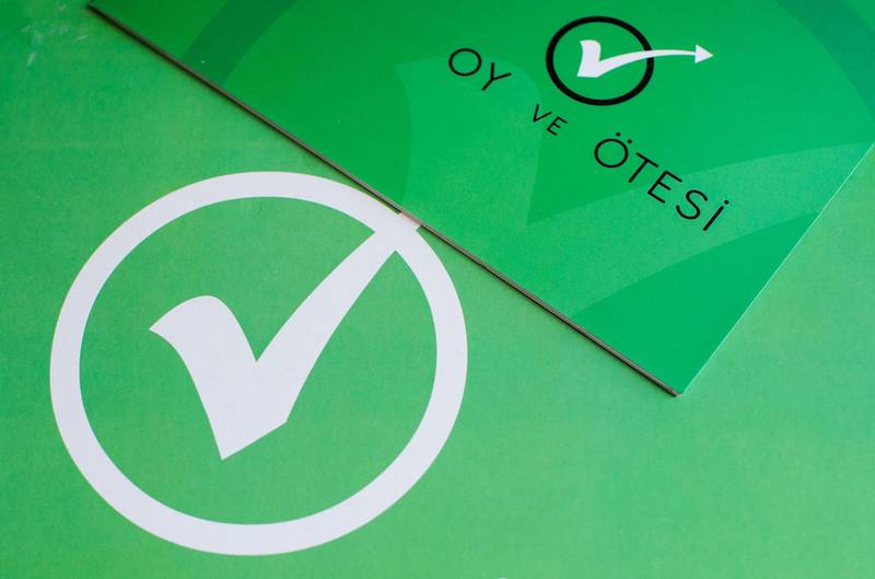 """This photo illustration taken on June 13, 2018 shows the """"Oy ve Otesi"""" (Vote and Beyond) logo from the Turkish NGO to promote election transparency, in Istanbul ahead of upcoming presidential and parliamentary elections. Opposition parties, associations and members of the public have united in an unprecedented way to organise monitoring of the polling stations to check for any irregularities ahead of Turkey's elections set for June 24. - TO GO WITH Turkey-vote-monitors-social,FOCUS by Gokan GUNES  / AFP / Yasin AKGUL / TO GO WITH Turkey-vote-monitors-social,FOCUS by Gokan GUNES"""