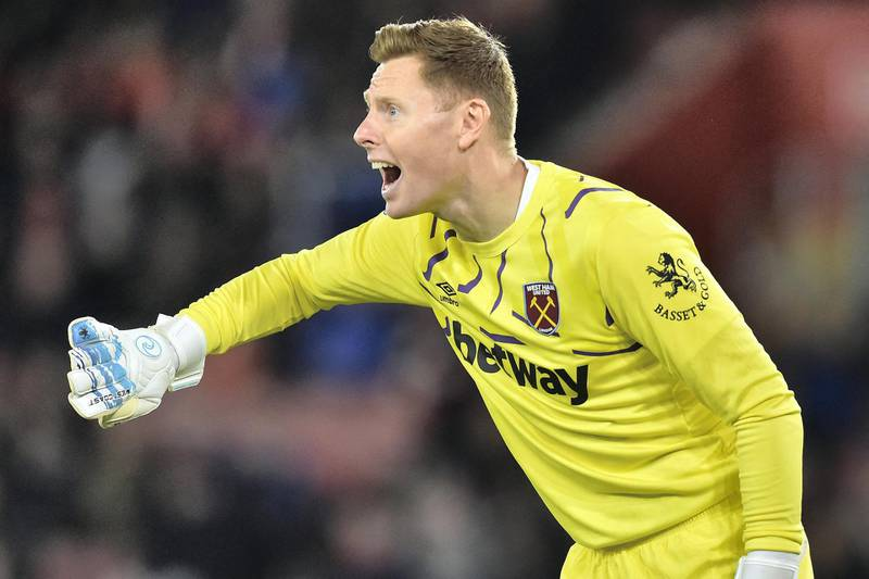 West Ham United's English goalkeeper David Martin gestures during the English Premier League football match between Southampton and West Ham United at St Mary's Stadium in Southampton, southern England on December 14, 2019. (Photo by Glyn KIRK / AFP) / RESTRICTED TO EDITORIAL USE. No use with unauthorized audio, video, data, fixture lists, club/league logos or 'live' services. Online in-match use limited to 120 images. An additional 40 images may be used in extra time. No video emulation. Social media in-match use limited to 120 images. An additional 40 images may be used in extra time. No use in betting publications, games or single club/league/player publications. /