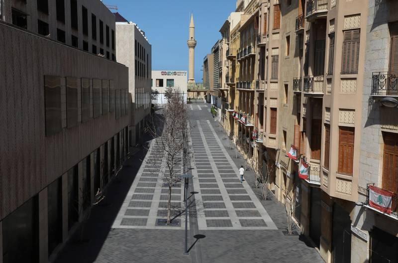A man walks along an empty shopping district in Beirut, Lebanon March 17, 2021. REUTERS/Mohamed Azakir