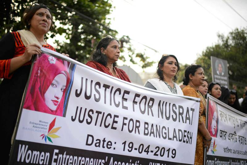 FILE - In this Friday, April 19, 2019, file photo, protesters gather to demand justice for an 18-year-old woman Nusrat Jahan Rafi who was killed after she was set on fire for refusing to drop sexual harassment charges against her Islamic school's principal, in Dhaka, Bangladesh. A court in eastern Bangladesh has sentenced the principal of the Islamic school and 15 others to death for killing Rafi, who died after being set on fire for refusing to drop sexual harassment charges against the principal. Judge Mamunur Rashid of the Women and Children Repression Prevention Tribunal on Thursday, Oct. 24, found Principal Siraj Ud Doula and others guilty of either killing her or ordering the murder in April. (AP Photo/Mahmud Hossain Opu, File)