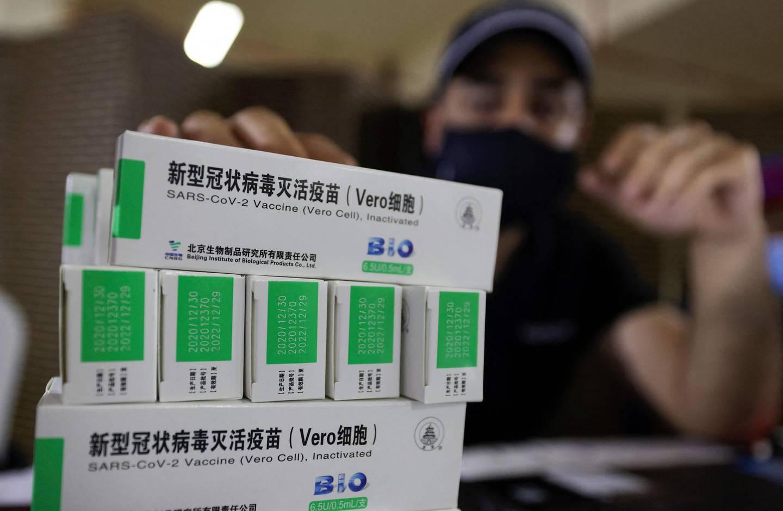 Boxes of China's Sinopharm COVID-19 vaccine are seen during vaccination at the Guru Nanak Darbar Gurudwara (Sikh temple) in Dubai on February 28, 2021.  / AFP / Karim SAHIB