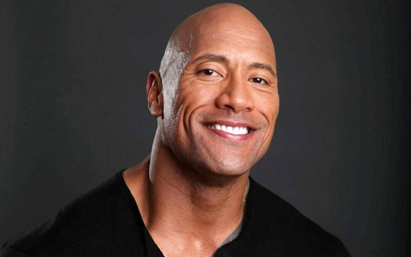 """FILE - This March 23, 2013 file photo shows actor Dwayne Johnson posing for a portrait at the Four Seasons in Los Angeles. Johnson also hosts """"The Hero,"""" competition series on TNT.  The season finale airs Thursday, Aug. 1. (Photo by Eric Charbonneau/Invision/AP, File)"""