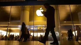 Apple shares rise on record quarterly profit