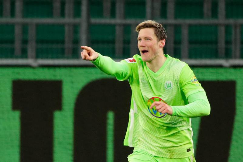 Wolfsburg's Dutch forward Wout Weghorst celebrates scoring the second goal during the German first division Bundesliga football match between WfL Wolfsburg vs Schalke 04, in Wolfsburg, on March 13, 2021.  - DFL REGULATIONS PROHIBIT ANY USE OF PHOTOGRAPHS AS IMAGE SEQUENCES AND/OR QUASI-VIDEO   / AFP / POOL / HANNIBAL HANSCHKE / DFL REGULATIONS PROHIBIT ANY USE OF PHOTOGRAPHS AS IMAGE SEQUENCES AND/OR QUASI-VIDEO