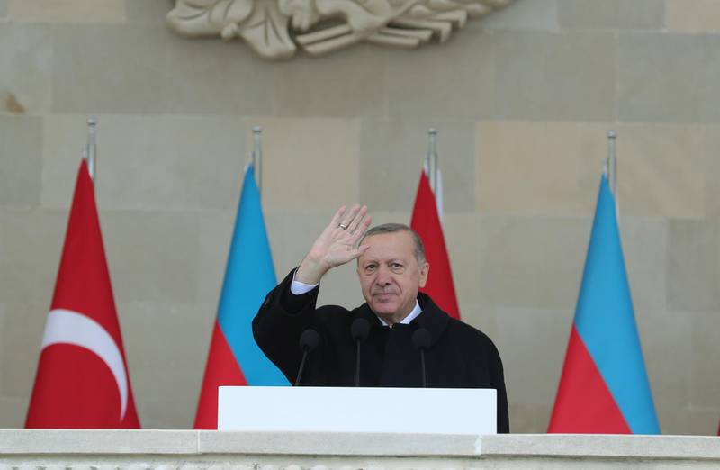 """A handout picture taken and released on December 10, 2020 by the Turkish presidential press service shows Turkish President Recep Tayyip Erdogan attending a military parade marking Azerbaijan's victory against Armenia in their conflict for control over the disputed Nagorno-Karabakh region, in Baku. RESTRICTED TO EDITORIAL USE - MANDATORY CREDIT """"AFP PHOTO / Turkish presidential press service / Mustafa KAMACI """" - NO MARKETING - NO ADVERTISING CAMPAIGNS - DISTRIBUTED AS A SERVICE TO CLIENTS  / AFP / TURKISH PRESIDENTIAL PRESS SERVICE / Mustafa Kamaci / RESTRICTED TO EDITORIAL USE - MANDATORY CREDIT """"AFP PHOTO / Turkish presidential press service / Mustafa KAMACI """" - NO MARKETING - NO ADVERTISING CAMPAIGNS - DISTRIBUTED AS A SERVICE TO CLIENTS"""