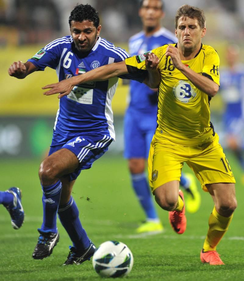 United Arab Emirates - Dubai - Saturday -26/01/2013 -  Al Wasl (yellow) team match with Al Nasr (blue) team within Etisalat league at the Al Wasl Stadium in Dubai. Ashraf Umrah / Al Ittihad