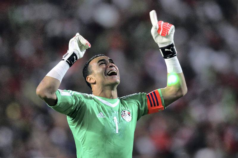 Egypt's Essam El-Hadary celebrates wining against Congo's team during their World Cup 2018 Africa qualifying match between Egypt and Congo at the Borg el-Arab stadium in Alexandria on October 8, 2017. Liverpool striker Mohamed Salah converted a stoppage-time penalty to give Egypt a dramatic 2-1 win over Congo Brazzaville Sunday and a place at the 2018 World Cup in Russia. / AFP PHOTO / TAREK ABDEL HAMID