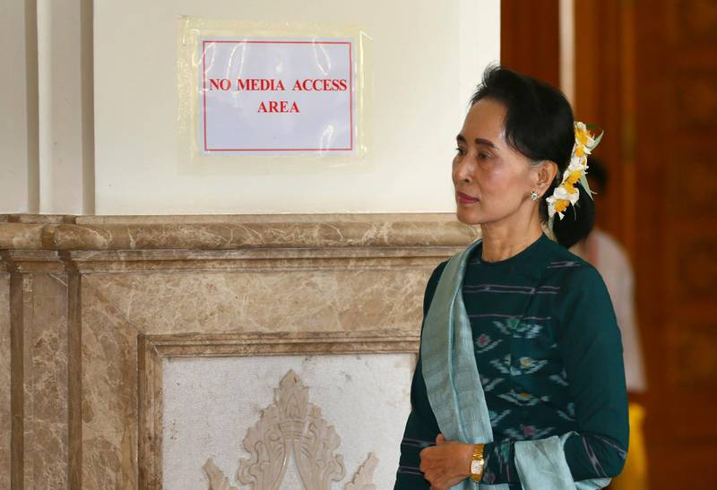 In this March 15, 2016 photo, Aung San Suu Kyi walks in Myanmar's parliament in Naypyitaw. Suu Kyi has expelled dissident party members, neglected to groom successors, spoken rarely to the press and apparently made command decisions rather than seeking help from capable advisers. (AP Photo/Gemunu Amarasinghe)