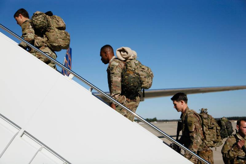 epa08110620 A handout photo made available by the US Army shows US paratroopers assigned to 1st Brigade Combat Team, 82nd Airborne Division boarding an aircraft bound for the US Central Command area of operations in the Middle East, from Fort Bragg, North Carolina, USA, 05 January 2020 (issued 07 January 2020). Tensions in the Middle East region are high following the killing of Iranian general Qasem Soleimani in a US airstrike in Baghdad on 03 January 2019.  EPA/HUBERT DELANY / US ARMY HANDOUT  HANDOUT EDITORIAL USE ONLY/NO SALES