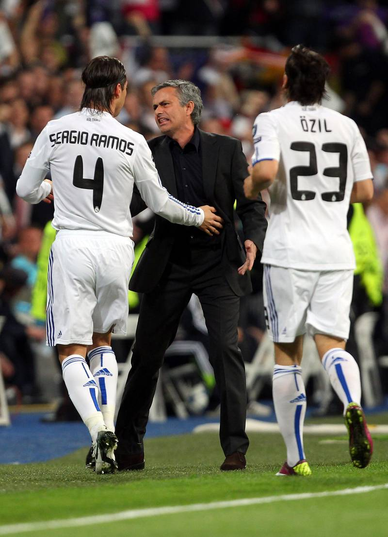 MADRID, SPAIN - APRIL 05:  Jose Mourinho of Real Madrid reacts to Sergio Ramos after Emmanuel Adebayor scores the opener the UEFA Champions League Quarter Final first leg match between Real Madrid and Tottenham Hotspur at Estadio Santiago Bernabeu on April 5, 2011 in Madrid, Spain.  (Photo by Clive Rose/Getty Images)