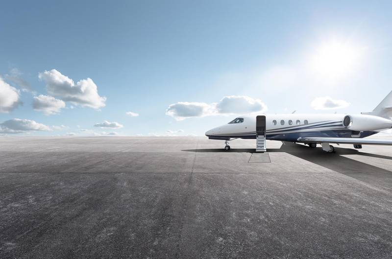 Private aircraft parked on the tarmac. Getty Images