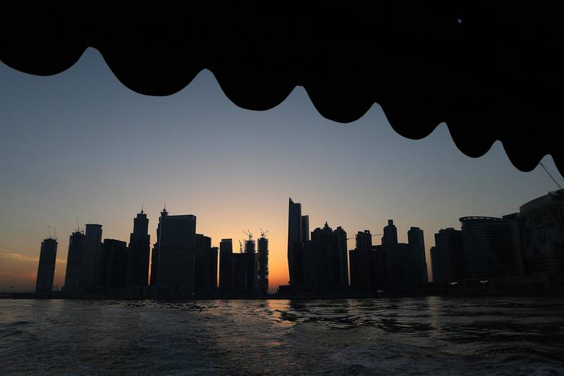 DUBAI , UNITED ARAB EMIRATES – May 17 , 2017 : View of the Dubai Skyline from the Abra at Dubai Water Canal in Dubai. The ticket price for one trip is 25 AED per person and the total time of this ride is around 45 minutes. People can see the Burj Khalifa and other buildings from Abra during the ride. ( Pawan Singh / The National ) For News / Photo Feature. ID No :- 18945 *** Local Caption ***  PS1705- DUBAI CANAL20.jpg