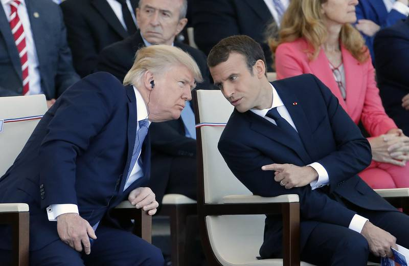 PARIS, FRANCE - JULY 14:  U.S President Donald Trump and French President Emmanuel Macron attend the traditional Bastille day military parade on the Champs-Elysees on July 14, 2017 in Paris France. Bastille Day, the French National day commemorates this year the 100th anniversary of the entry of the United States of America into World War I.  (Photo by Thierry Chesnot/Getty Images)