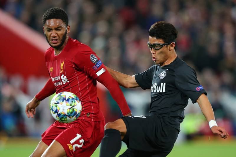 LIVERPOOL, ENGLAND - OCTOBER 02: Joe Gomez of Liverpool and Hwang Hee-chan of Red Bull Salzburg during the UEFA Champions League group E match between Liverpool FC and RB Salzburg at Anfield on October 02, 2019 in Liverpool, United Kingdom. (Photo by Alex Livesey/Getty Images)