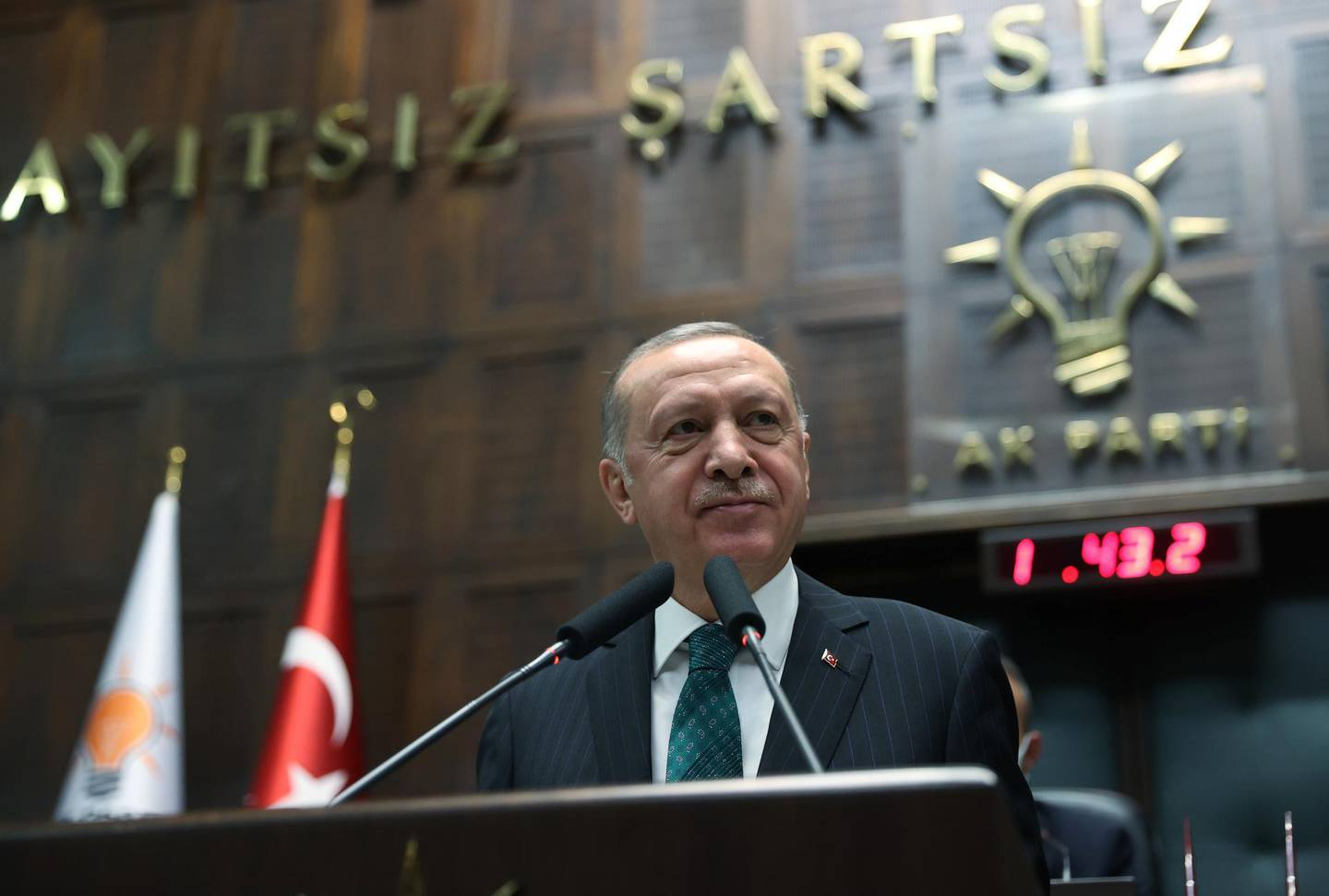 Turkish President Tayyip Erdogan addresses members of parliament from his ruling AK Party (AKP) during a meeting at the Turkish parliament in Ankara, Turkey, February 10, 2021. Murat Cetinmuhurdar/PPO/Handout via REUTERS THIS IMAGE HAS BEEN SUPPLIED BY A THIRD PARTY. NO RESALES. NO ARCHIVES