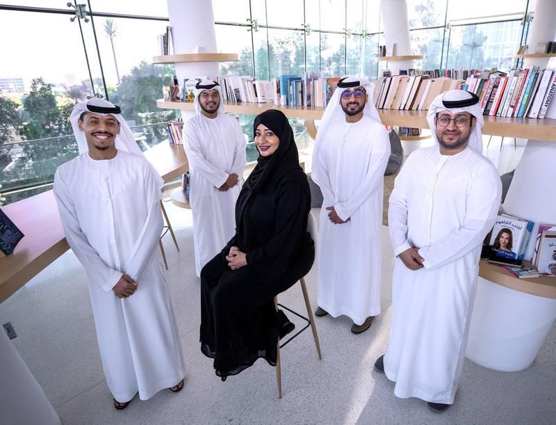 Abu Dhabi, United Arab Emirates, November 4, 2020.   A group of Emiratis launch an innovative design of a fountain, that simulates the launch of the Hope probe, called the Space Fountain. (L-R) Hamad Al Nuaimi, Sadeq Al Katheri, Muna Al Aidaros, Abdulaziz Al Mheiri and Salem Al Messabi.Victor Besa/The NationalSection:  NAReporter:  Ruba Haza