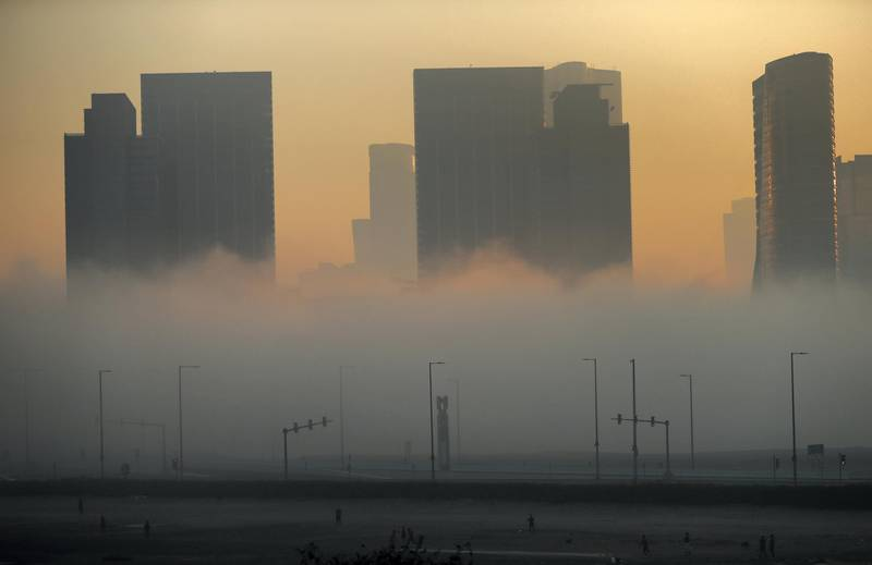 Abu Dhabi - United Arab Emirates - 22Dec2017 - Dense fog engulfed Abu Dhabi city in the morning having poor visibilty for motorist. Ravindranath K / The National