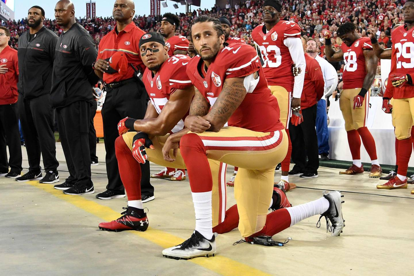 (FILES) In this file photo taken on September 11, 2016  Colin Kaepernick #7 and Eric Reid #35 of the San Francisco 49ers kneel in protest during the national anthem prior to playing the Los Angeles Rams in their NFL game at Levi's Stadium in Santa Clara, California. Former NFL star Colin Kaepernick, who launched kneeling protests during US national anthems to protest police brutality and racial injustice, will be the subject of a six-part series, Netflix announced June 29, 2020. -   / AFP / GETTY IMAGES NORTH AMERICA / Thearon W. Henderson