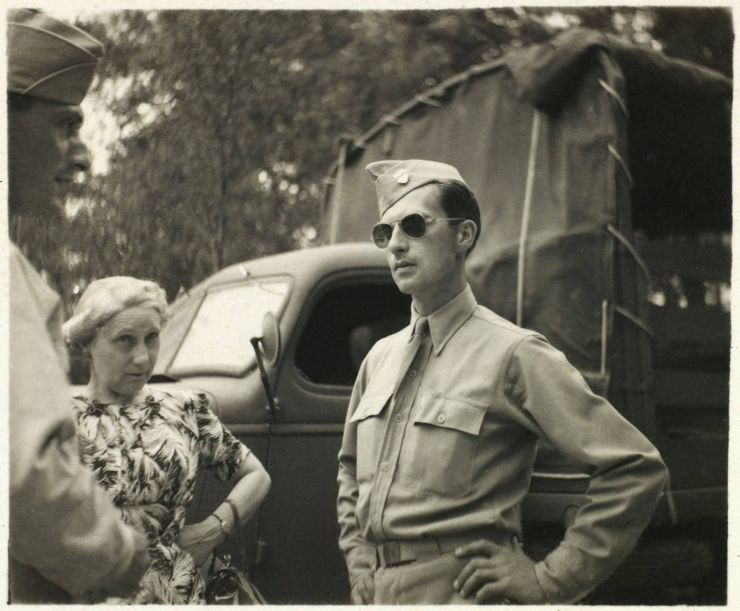 Soldier in Uniform and Aviator Sunglasses with Another Soldier and Civilian Woman, Portrait, WWII, HQ 2nd Battalion, 389th Infantry, US Army Military Base, Indiana, USA, 1942. (Photo by: Universal History Archive/UIG via Getty Images)