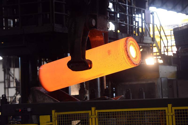 (FILES) In this file photo taken on April 15, 2013 a steel tube is being produced at a steel tubes factory in Duesseldorf, western Germany.  Imposed stiff tariffs by the United States on European, Mexican and Canadian steel and aluminium, that have come into effect on June 1, 2018, have sparked immediate countermeasures by Mexico and Canada, while the European Union threatened a similar response, throwing up the prospect of a painful conflict between some of the world's biggest economies. / AFP / Patrik STOLLARZ