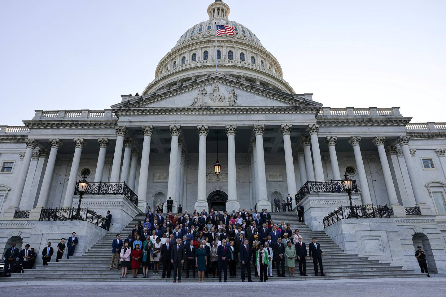FILE PHOTO: Members of Congress observe a moment of silence for the 600,000 American lives lost to the coronavirus disease (COVID-19), outside the U.S. Capitol in Washington, U.S., June 14, 2021. REUTERS/Evelyn Hockstein/File Photo