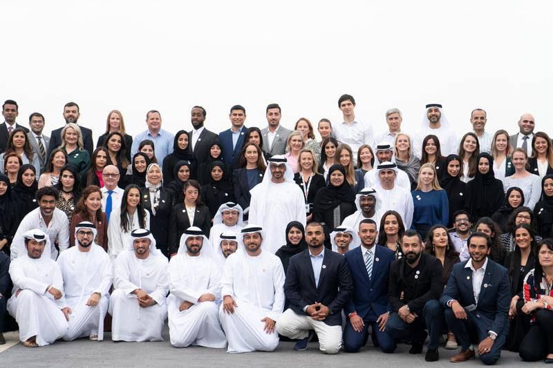 ABU DHABI, UNITED ARAB EMIRATES - March 25, 2019: HH Sheikh Mohamed bin Zayed Al Nahyan Crown Prince of Abu Dhabi Deputy Supreme Commander of the UAE Armed Forces (2nd row centre), stands for a group photograph with Special Olympics World Games Abu Dhabi 2019 organisers, during a Sea Palace barza.   ( Rashed Al Mansoori / Ministry of Presidential Affairs )