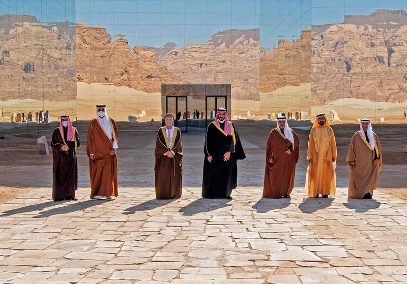 """A handout picture provided by the Saudi Royal Palace on January 5, 2021, shows from L to R: Kuwaiti Emir Sheikh Nawaf al-Ahmad Al-Sabah, Emir of Qatar Tamim bin Hamad Al-Thani, Omani Deputy Prime Minister Fahd Bin Mahmud, Saudi Crown Prince Mohammed bin Salman, Bahrain's Crown Prince Salman bin Hamad Al-Khalifa, Dubai's Ruler and UAE Vice President Sheikh Mohammed bin Rashid Al-Maktoum and Nayef al-Hajraf, secretary-general of the Gulf Cooperation Council (GCC) posing for a pictures before the opening session of the 41st Gulf Cooperation Council (GCC) summit in the northwestern Saudi city of al-Ula. - Saudi Arabia's Crown Prince Mohammed bin Salman said that the Gulf states had signed an agreement on regional """"solidarity and stability"""" at a summit aimed at resolving a three-year embargo against Qatar. (Photo by BANDAR AL-JALOUD / Saudi Royal Palace / AFP) / RESTRICTED TO EDITORIAL USE - MANDATORY CREDIT """"AFP PHOTO / SAUDI ROYAL PALACE / BANDAR AL-JALOUD"""" - NO MARKETING - NO ADVERTISING CAMPAIGNS - DISTRIBUTED AS A SERVICE TO CLIENTS"""