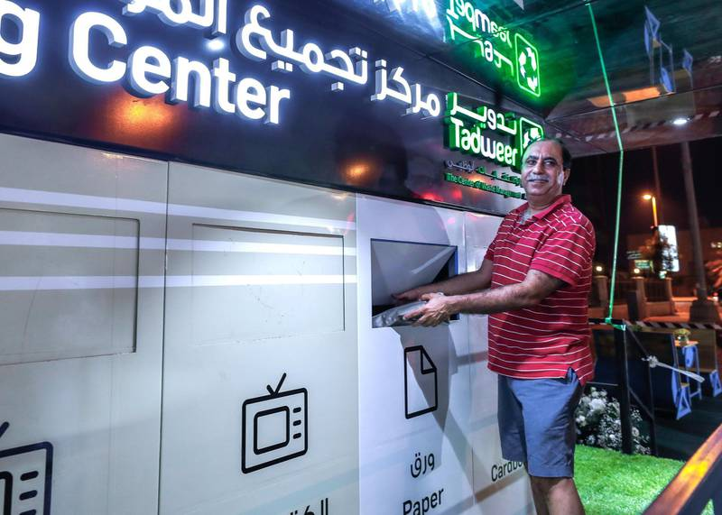 Abu Dhabi, U.A.E., July 3, 2018.   Mr. Sunil Thawani, 60, an Al Khalidiya resident does his part in recycling his trash during the opening of the first civic amenity in Abu Dhabi to promote waste segregation at source.  Victor Besa / The NationalReporter - Haneen DajaniSection:  NA