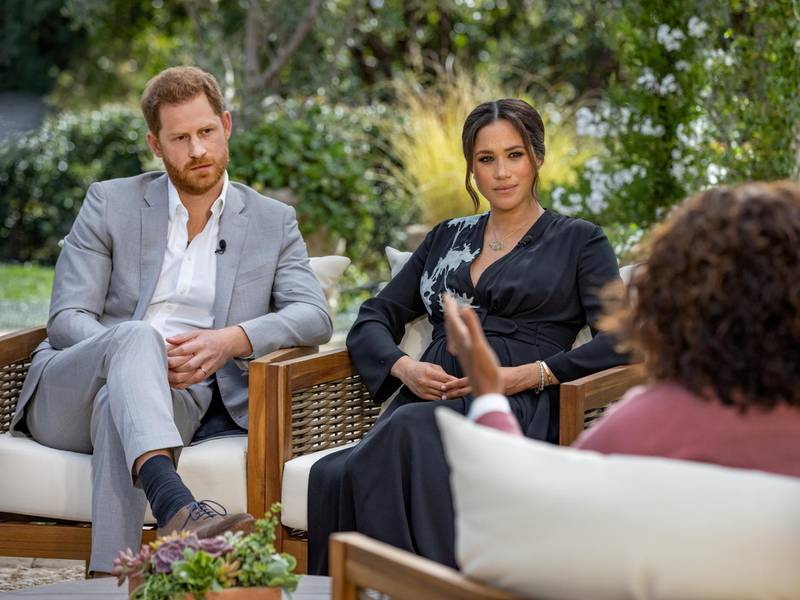 FILE PHOTO: Britain's Prince Harry and Meghan, Duchess of Sussex, are interviewed by Oprah Winfrey in this undated handout photo.  Harpo Productions/Joe Pugliese/Handout via REUTERS/File Photo