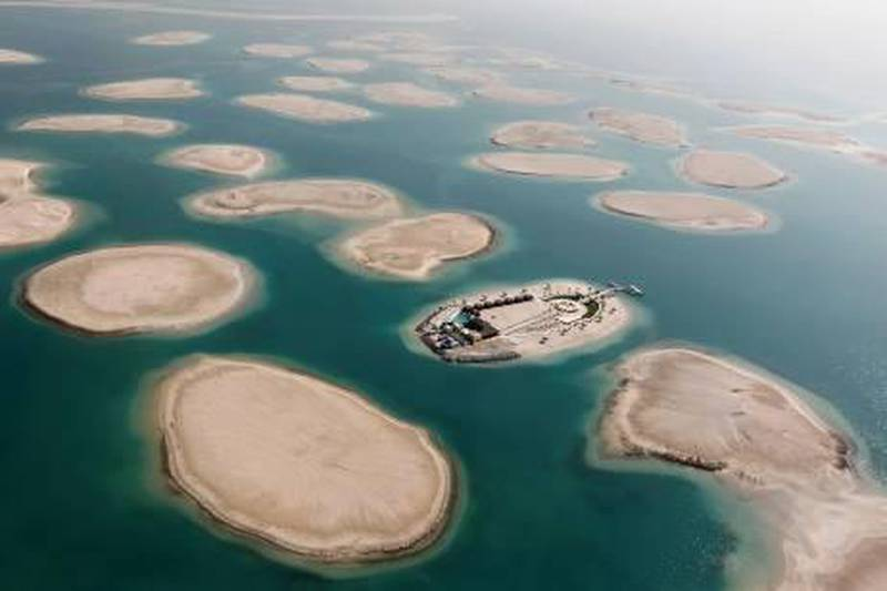 A development is seen on one of the islands of The World Islands project in Dubai January 7, 2012. The World Islands is located approximately 4 km (2.5 miles) off the coast of Jumeirah. The collection of man-made islands are shaped into the continents of the world, and will consist of 300 small private artificial islands divided into four categories - private homes, estate homes, dream resorts, and community islands, according to the development company Nakheel Properties Group. REUTERS/Jumana El Heloueh (UNITED ARAB EMIRATES - Tags: CITYSPACE REAL ESTATE BUSINESS SOCIETY WEALTH) *** Local Caption ***  DUB05_EMIRATES-_0107_11.JPG