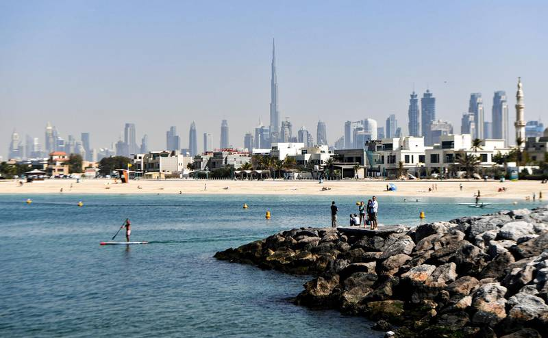 This picture taken on February 1, 2020 shows a view from La Mer North marina in Dubai, with the Burj Khalifa and the Dubai skyline seen in the background. (Photo by KARIM SAHIB / AFP)