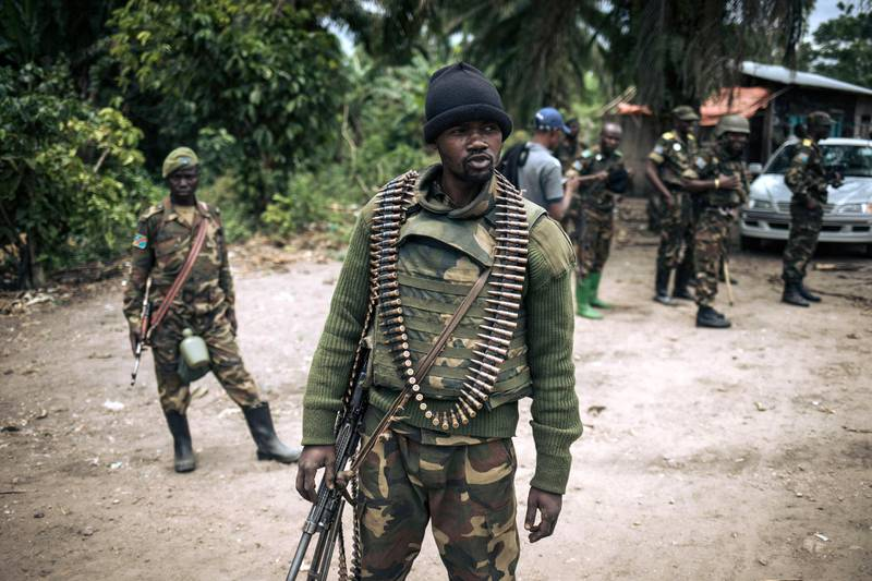(FILES) In this file photo taken on February 18, 2020 an Armed Forces of the Democratic Republic of Congo (FARDC) soldier takes part in a foot patrol in the village of Manzalaho near Beni, following an attack allegedly perpetrated by members of the rebel group Allied Democratic Forces (ADF). A group of UN experts overseeing sanctions in the Democratic Republic of Congo has warned of a proliferation of homemade bombs in the country's northeast, in an annual report seen by AFP June 15, 2021. / AFP / Alexis Huguet
