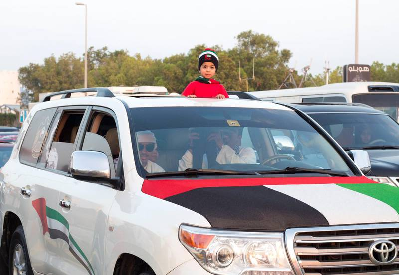 Abu Dhabi, United Arab Emirates - People parade their vehicles with UAE stickers on their car at Abu Dhabi Corniche, Breakwater.  Leslie Pableo for The National